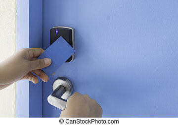 left hand hold key card touch on electronic pad lock access...