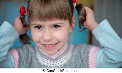 The little girl with pigtails
