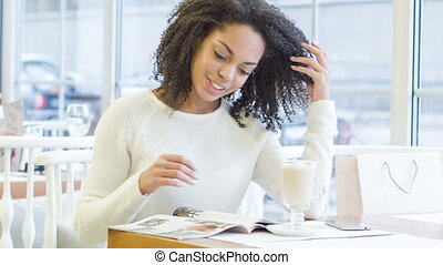 Young woman reading a magazine. - Plenty of articles....