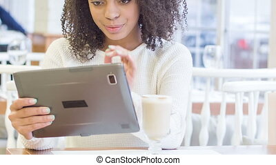 Young woman using digital tablet.