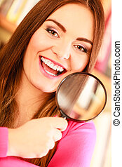 Girl holding magnifying glass - Investigation exploration...