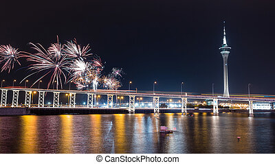 The old Macau-Taipa Bridge and Macau tower with fireworks at...