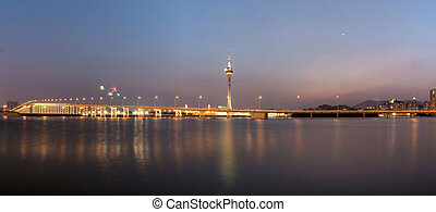 The old Macau-Taipa Bridge and Macau tower with moon