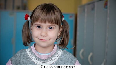 Beautiful girl with pigtails who smiles