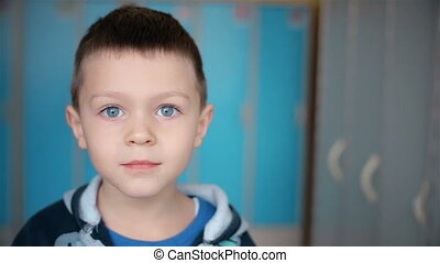 Portrait of adorable small boy looking at camera