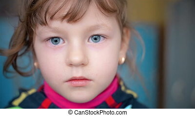 Portrait of a child who looks into the camera HD