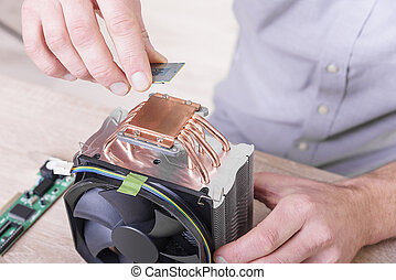 Cpu cooler installation. - Engineer installing computer...