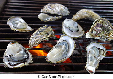 Delicious seafood - raw oyster - Grilling the delicious...