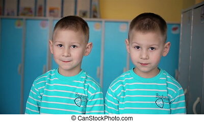 Looking twins boys in camera HD