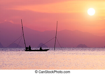 Silhouettes of fisherman at the lake with pastel color image.