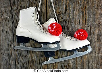 ice skates with red yarn pompoms - Pair of white ice skates...