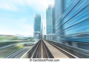 Railway - Light railway and modern building with blur motion