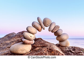 Stone arch on coast - Pebbles in the form of a arch on coast