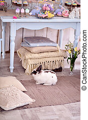 Easter bunny and decoration - under the table with Easter...