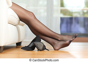 Tired woman legs resting on couch - Profile of a tired woman...
