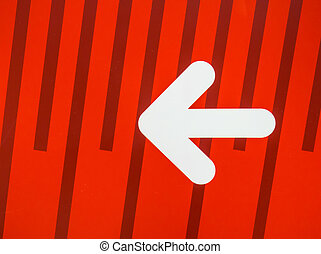 White arrow sign on red background