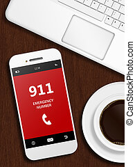 mobile phone with 911 emergency number lying on desk