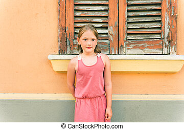 Outdoor portrait of a cute little girl of 7-8 years old,...