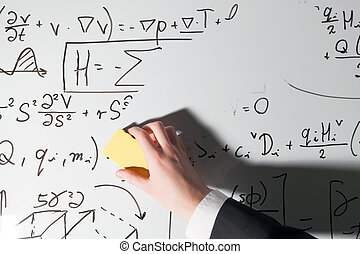 Whiping the whiteboard. Complex math formulas. Mathematics and science