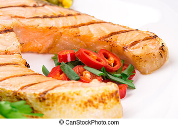 Fried salmon fillet Isolated on a white background