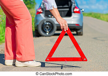 install an emergency stop sign on the pavement near the...