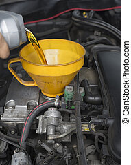 Car servicing lubricant oil engine. - Car servicing mechanic...