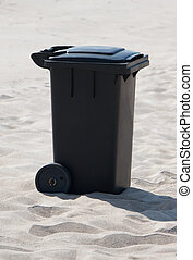 trash can on sand