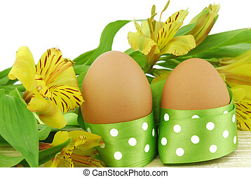 easter egg and flowers with green bow isolated