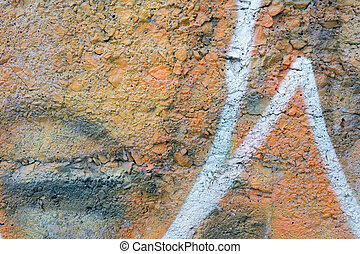 Orange Aged Wall Made of Small Rocks with white lines
