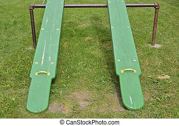 Twin green teeter totters - Two identical twin green teeter...