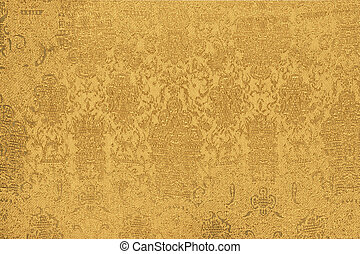 gold fabric - shiny gold fabric with a pattern closeup
