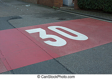 Maximum speed 30 - Speed limit 30 painted on asphalt