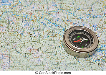 Compass and map The magnetic compass is lying on a...