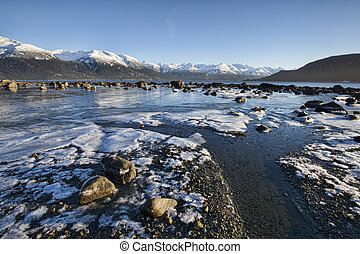 Outgoing Tide with Ice - Icy beach near Haines Alaska with...