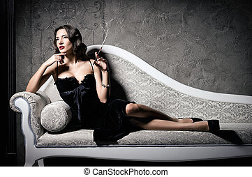 Film noir style: gorgeous beautiful young woman lying on...