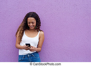 Woman reading a text message on mobile phone