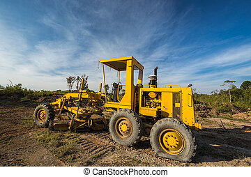 Wheel loader Excavator with flat tire in the field
