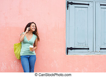 Happy woman talking on mobile phone outdoors - Outdoors...