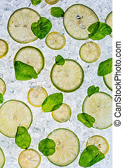 Close up of lime on ice drift - Close up of lime slices...