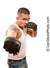 Hispanic Man with Boxing Gloves - Hispanic man in t-shirt...