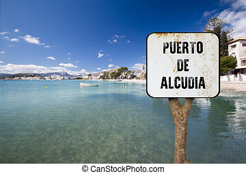 wooden sign indicating alcudia - trunk and sign indicating...