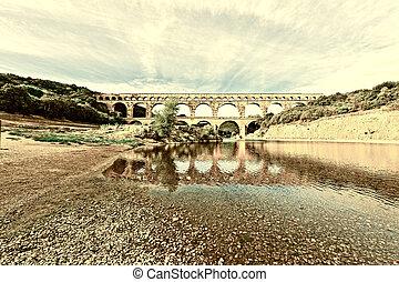 Aqueduct - Ancient Roman Aqueduct Pont du Gard in France,...