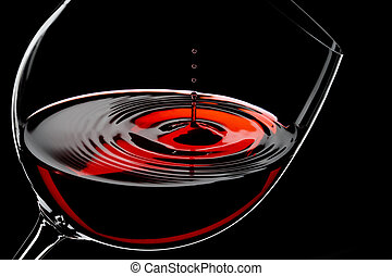 wine drops - glass of red wine, drops in motion, studio shot