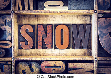 Snow Concept Letterpress Type - The word Snow written in...