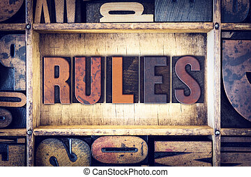 Rules Concept Letterpress Type - The word Rules written in...