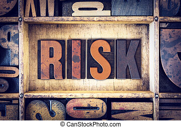 Risk Concept Letterpress Type - The word Risk written in...
