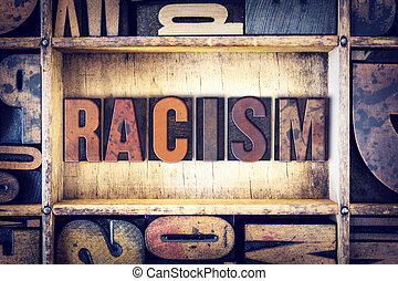 Racism Concept Letterpress Type - The word Racism written in...