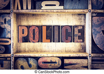 Police Concept Letterpress Type - The word Police written in...