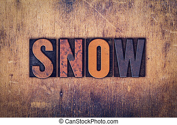 Snow Concept Wooden Letterpress Type - The word Snow written...