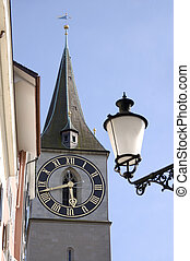 Clock face and street lamp